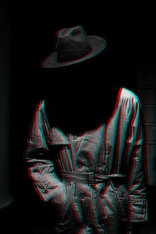 Dark mystical silhouette of a man in a hat at night. black and white with 3d glitch virtual reality effect