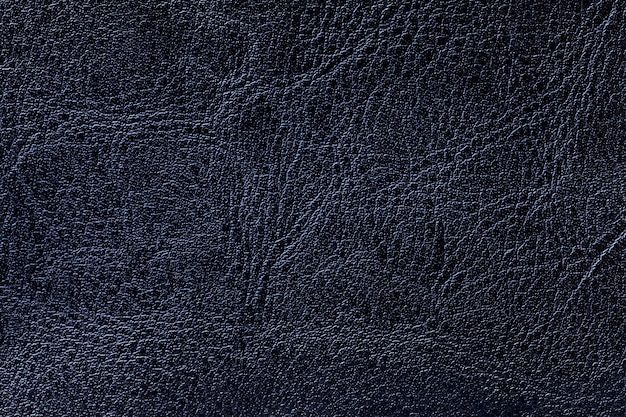 Dark navy blue leather texture background, closeup