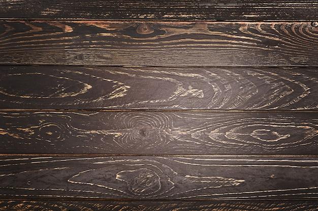 暗い古い木製テーブルテクスチャ背景