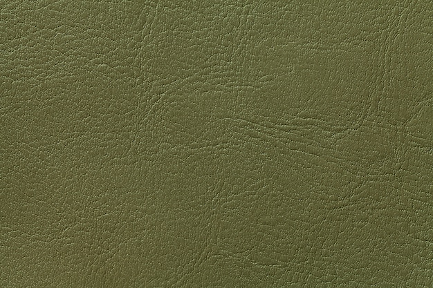 Dark olive leather texture background, closeup. green cracked backdrop