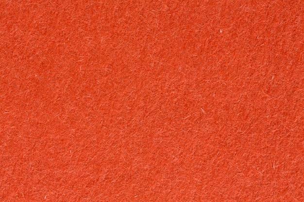 濃いオレンジ色の紙の質感、クローズアップ。高解像度の写真。