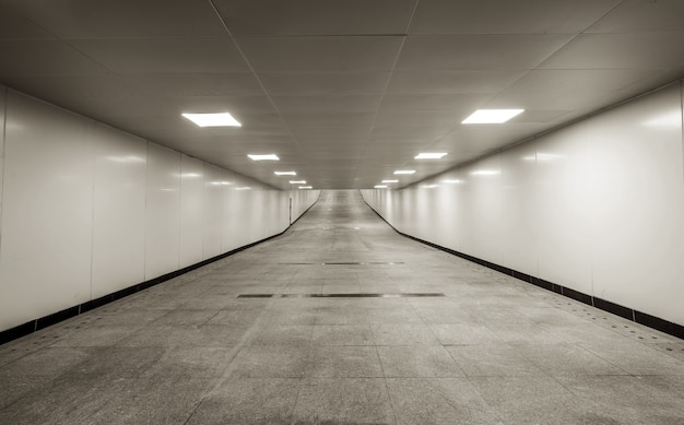 The dark pedestrian tunnel is empty and empty.