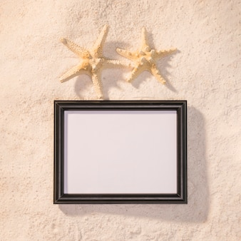 Dark picture frame with starfishes