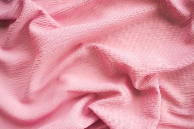 濃いピンクの生地のテクスチャの抽象的な背景。新しいモダンなデザインの豪華な光と柔らかな波の滑らかな形のシルクの壁紙。空きスペースのあるフラットレイ。カードポスターやプレゼンテーション製品のコンセプトに。