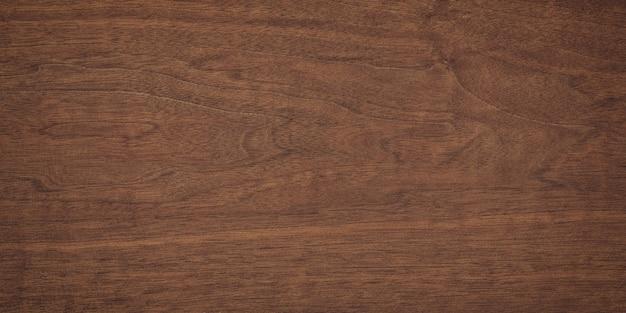 暗い板の背景、素朴な木製のテーブルの表面。茶色の木の質感