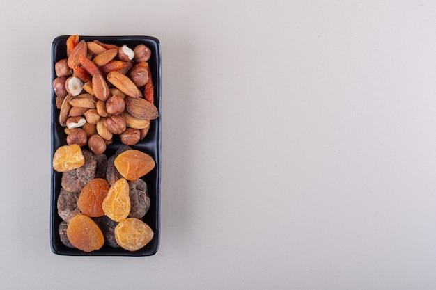 Dark plate of various organic nuts