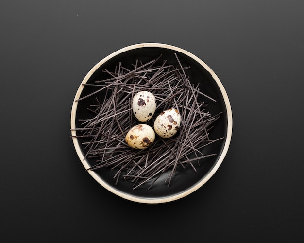Dark plate with eggs on a dark background