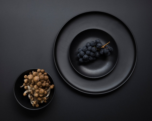 Dark plate with grapes on a black background