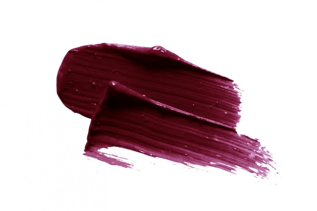 Dark plum color lipstick smear isolated on white