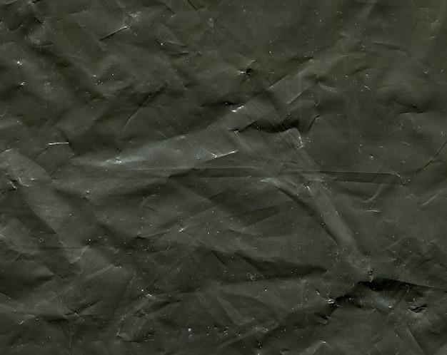 暗いポリエチレンテクスチャ背景