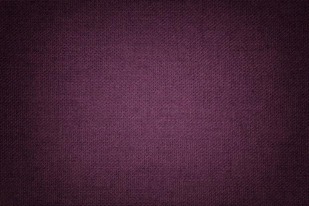 Темно-фиолетовый фон из текстильного материала с плетеным узором