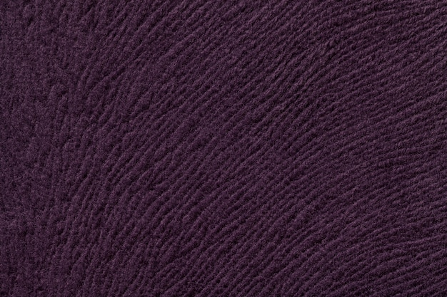Dark purple background from soft textile material. fabric with natural texture.
