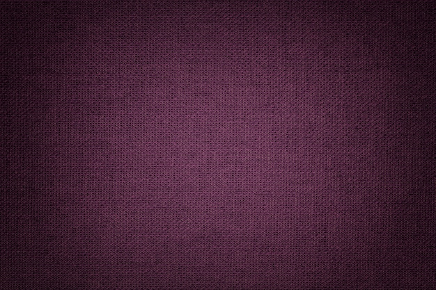 Dark purple background from a textile material with wicker pattern