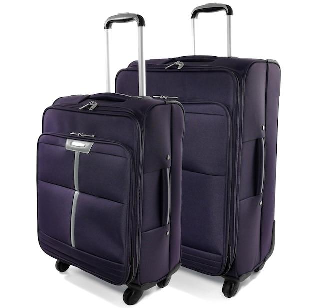 白い背景で隔離の濃い紫色のバッグ