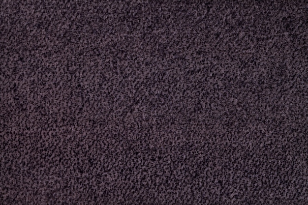 Dark purple fluffy background of soft, fleecy cloth