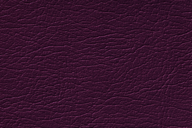 Dark purple leather texture background with pattern, closeup