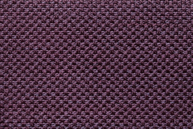 Dark purple textile background with checkered pattern, closeup. structure of the fabric macro.