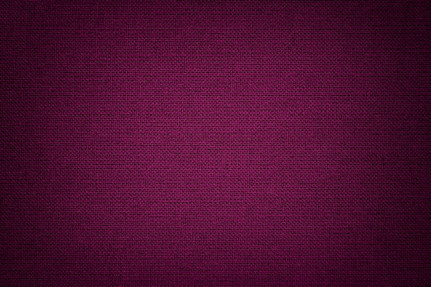 Dark purple a textile material, fabric with natural texture.