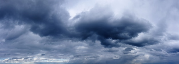 Dark rainy clouds in the stormy sky. wheather forecast. sky panorama.