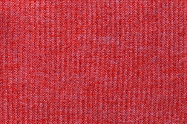 Dark red background from a textile material. fabric with natural texture. backdrop.