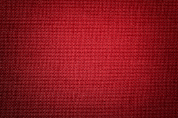Dark red background from a textile material with wicker ,