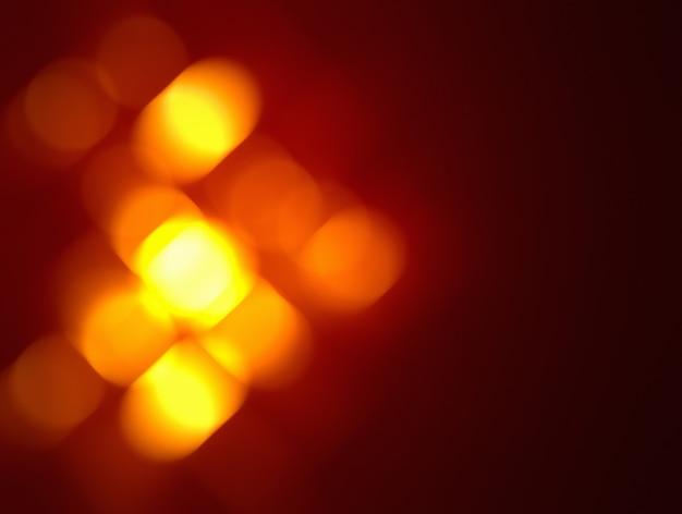 Темно-красный фон с ярким эффектом боке