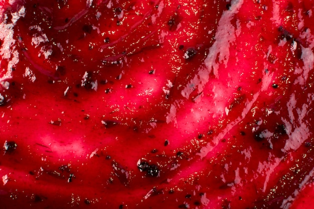 Dark red berry jam spreaded on flat background or