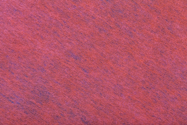 Dark red and blue background of felt fabric