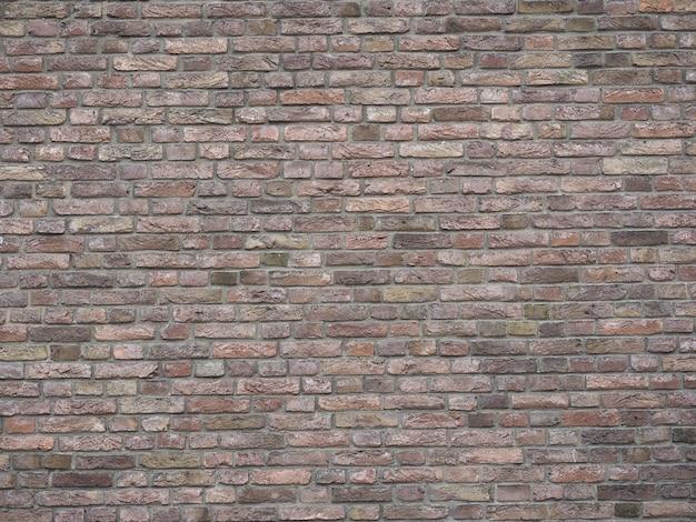 Темно-красная кирпичная стена фон