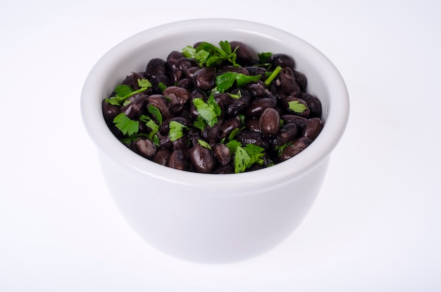 Dark red canned beans in white bowl.