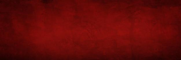 濃い赤のセメントのテクスチャと壁紙