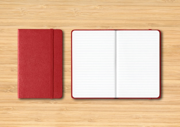 Dark red closed and open lined notebooks mockup isolated on wooden