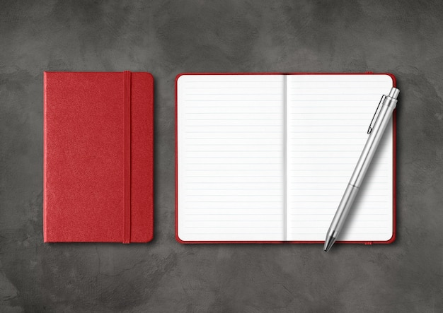 Dark red closed and open lined notebooks with a pen. mockup isolated on black concrete background