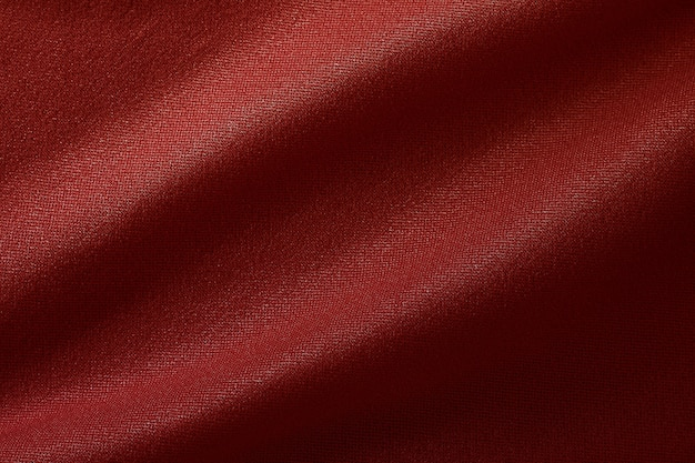 Dark red fabric cloth texture for background and design art work, beautiful crumpled pattern of silk or linen.