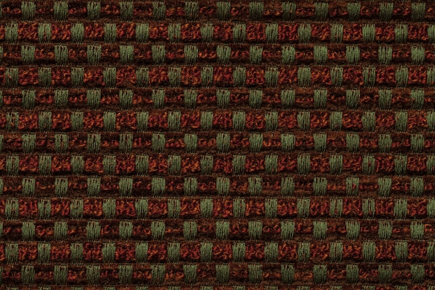 Dark red and green background from checkered pattern textile