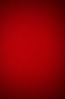 Dark red grunge background texture of old paper, vintage retro vignette