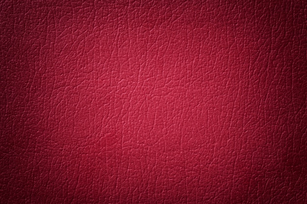Dark red leather texture background.