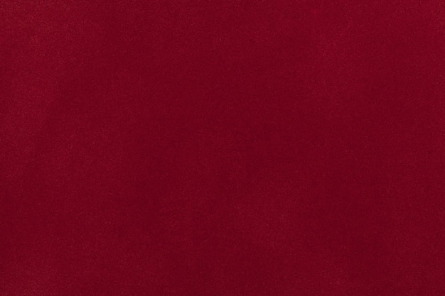 Темно-красная замшевая ткань крупным планом. бархатная текстура фон