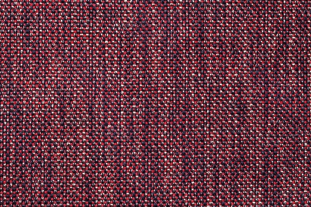 Dark red textile background, closeup. structure of the fabric macro.