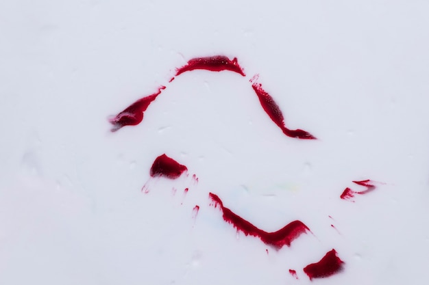 Dark red watercolor stains isolated over white background