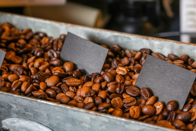 Dark roast coffee beans in the tray
