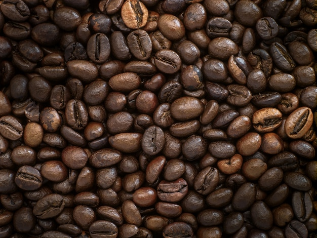 Dark roasted robusta and arabica coffee beans background picture, top view