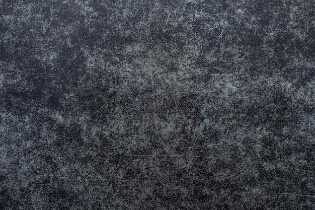 Темный поцарапанный гранж-фон, эффект старого фильма, место для текста или изображения.