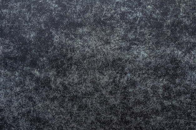Dark scratched grunge background, old film effect, space for your text or picture.