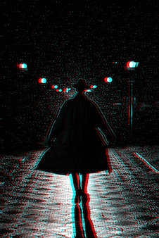 Dark silhouette of a man in a coat and hat in the rain on a night street. black and white with 3d glitch virtual reality effect