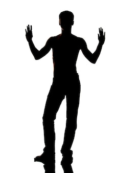 Dark silhouette of man in jeans and naked torso with hands up, on white background