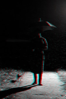 Dark silhouette of a man in a raincoat and hat under an umbrella on the street in the rain. black and white with 3d glitch virtual reality effect
