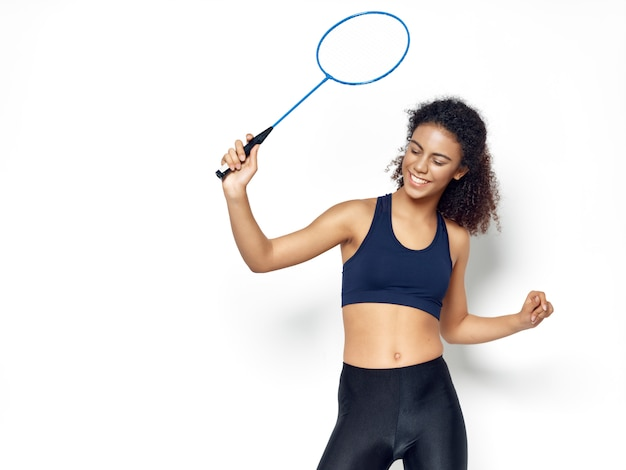 Dark-skinned african american woman posing in a tracksuit and doing sports space
