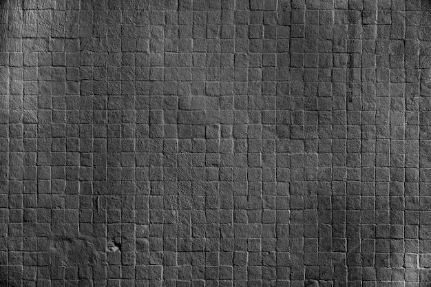 Dark square brick wall