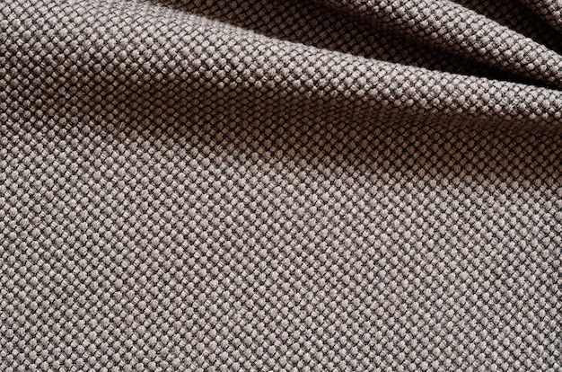 Темный текстильный фон со складками